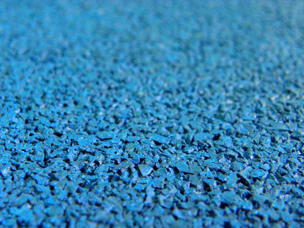 Поверхность синей резиновой плитки